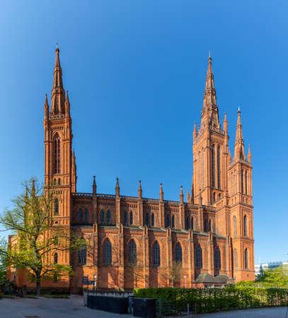 famous old market church in Wiesbaden under blue sky Фото со стока