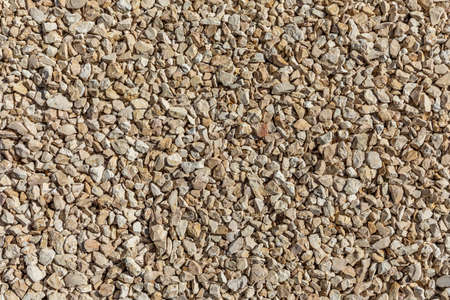 small gravel stones in sun give a harmonic background Фото со стока