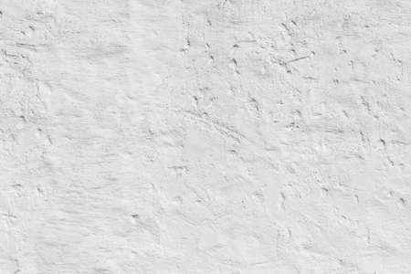 pattern of old plaster wall painted in white gives a harmonic background