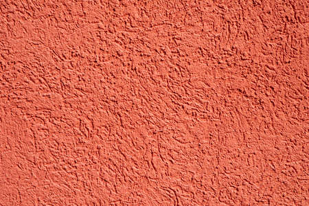 background of bright red plaster wall with harmonic structure Stock Photo