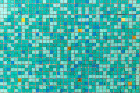harmonic background of small squares in green color with red, blue and yellow spots