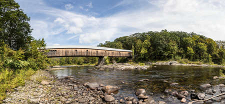 Longest covered bridge in Brattleboro Vermont over the West river, New England Фото со стока