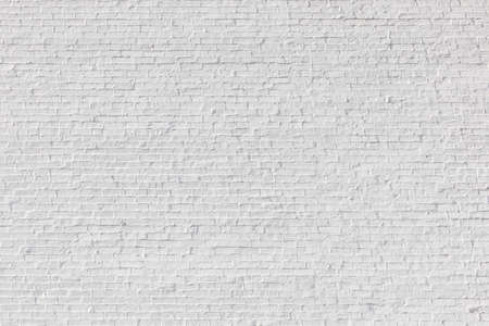 old harmonic brick wall painted in white