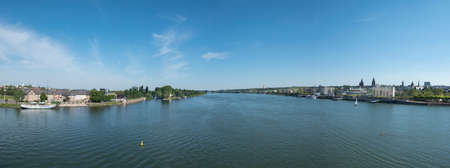 View to skyline of Mainz with river Rhine under blue sky