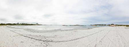 empty sandy beach on a cloudy day in Newport, USA Фото со стока