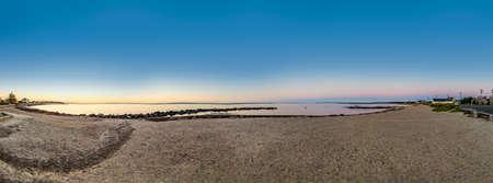 early morning sunrise at the atlantic ocean in Falmouth, MA, USA Фото со стока