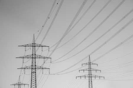 crossing electric pylon in sunset sky Фото со стока