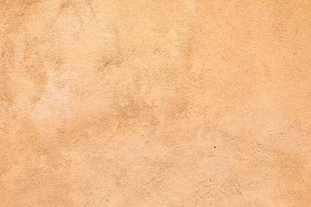 harmonic background of orange plaster wall