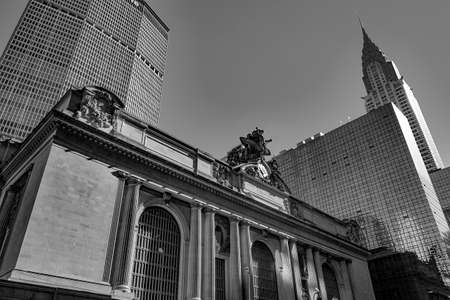 New York, USA - October 4, 2017: Grand central building with eagle at entrance and chrysler and MEetlife building in background.