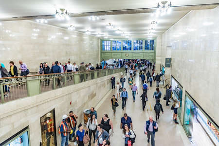 NEW YORK, USA - OCT 5, 2017: people hurry in grand central terminal in art nouveau style downtown Manhattan. Grand Central is the most famous train station in the USA.