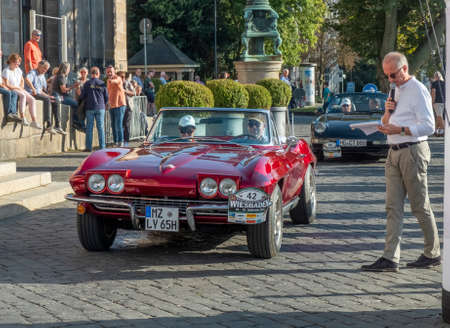 Wiesbaden, Germany - September 24, 2021: the chevrolet Corvette reaches the final goal of the Oldtimer ralley Wiesbaden in Wiesbaden after a challenge in the Rheingau, Germany. Редакционное