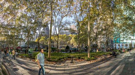 New York, USA - October 5, 2017: people rest in the Bryant Park downtown Manhattan, New York.