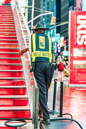 New York, USA - October 5, 2017: security man in early morning watches the people at Times Square in early morning. Редакционное