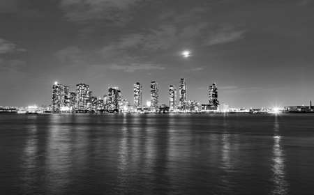 panoramic view of New York by night with Hudson River