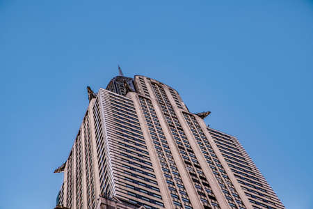 New York, USA - October 6, 2017: At 1,046 feet (318.9 m), spire, crown and facade of the Crysler Building in the afternoon in bright sun in New York, USA.