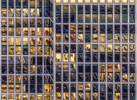 Frankfurt, Germany - JAN 17, 2017: facade of an office building in Frankfurt by night.