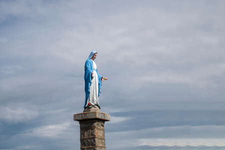 summit of the mountain petit Ballon in the Alsace region of France with statue of holy Mary at top