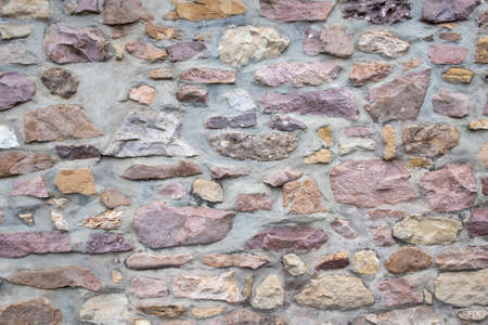 background of old stone wall in rough structure Фото со стока