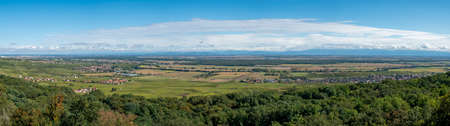 scenic panoramic view from Pfaffenheim to valley of Ruffach and view to Kaiserstuhl and black forest in Germany