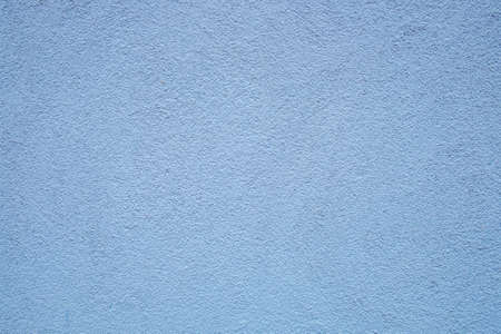 background of old blue plaster in rough structure