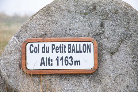 signage col du petit ballon, engl: top of mountain small Ballon, in the Alsace, France Фото со стока