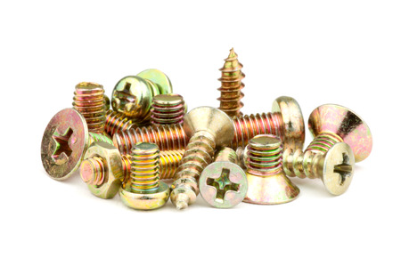 A small assortment of bronze-colored screws Stock Photo