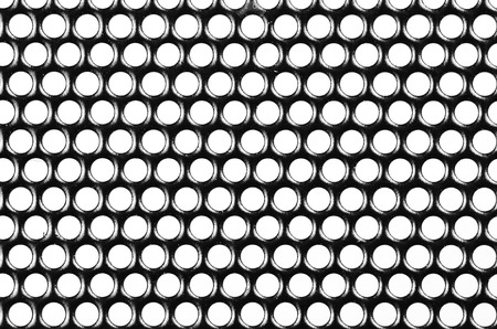 Small metal grille texture with white circular openings Stock Photo