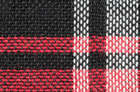 sewn up: Black, red and white woven texture