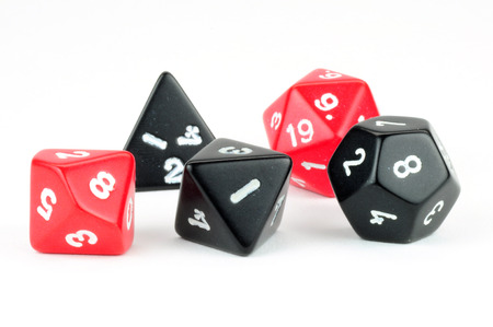 Macro photo of five black and red dice on white