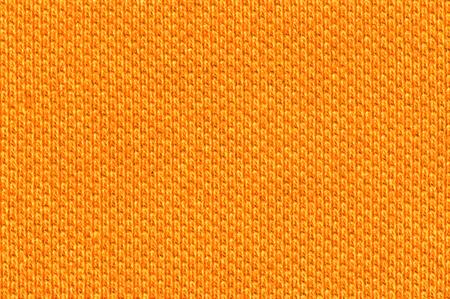Photo of a bright orange cotton texture Stock Photo