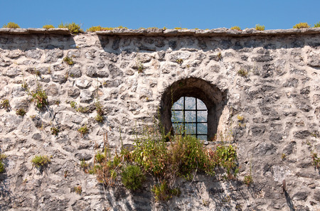 Medieval wall with small window