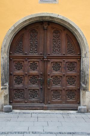 An ornately carved doorway in Regensburg, Germany Stock Photo