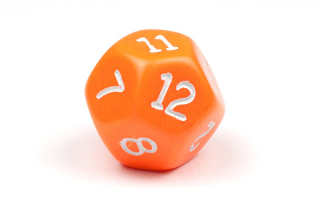 A single, orange, 12-sided die on white 版權商用圖片