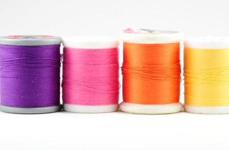 Four spools of thread on white Stock Photo