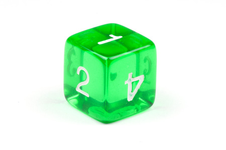 A single green, translucent six-sided die on white