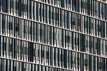 Photo of a London, UK office building with narrow vertical windows