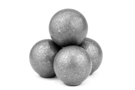 Stack of four lead musket balls on white