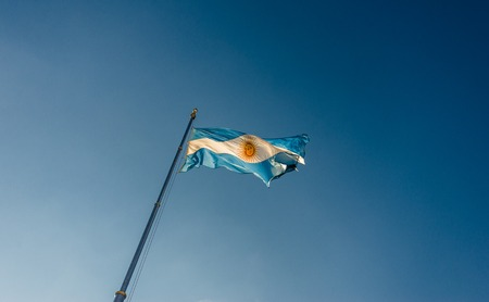 Argentina flag waving against blue sky on a sunny day