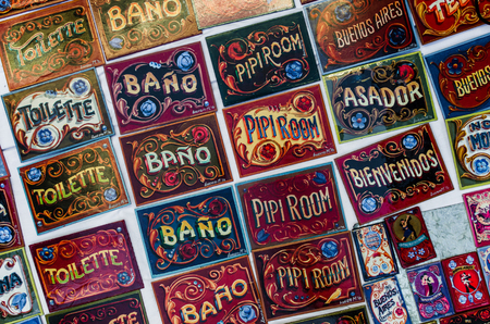 Colored door signs, made in traditional Buenos Aires style of painting fileteado Stock Photo