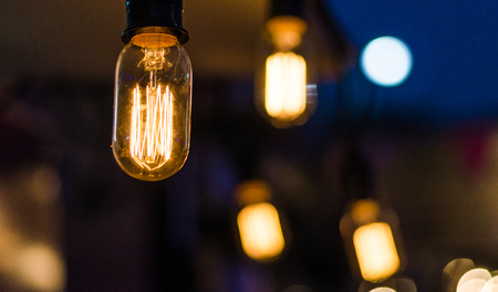 Hanging light bulbs at a street food market