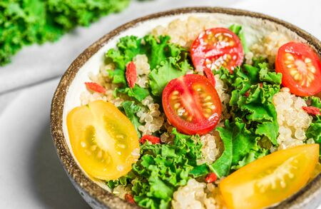 Quinoa, goji berry, and kale vegetable salad in a bowl