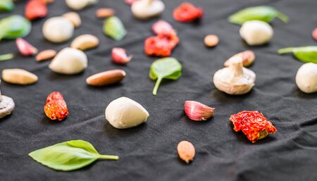 Selection of different Italian food ingredients against black background