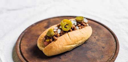 Traditional texas style hot dog against white background