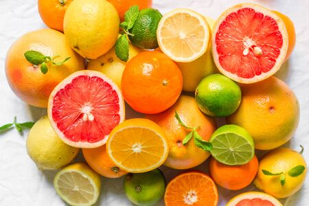 Colorful citrus fruit like lemon, lime, orange, grapefruit, tangerine