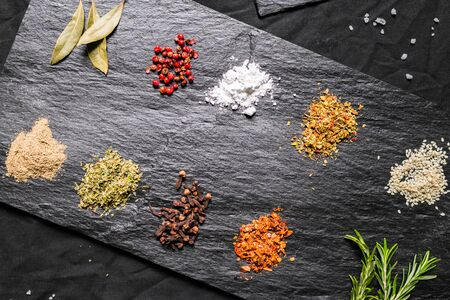 Large selection of different colorful contrast spices and seeds Фото со стока