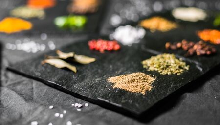 Large selection of different colorful contrast spices and seeds Zdjęcie Seryjne
