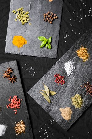Large selection of different colorful contrast spices and seeds Stock Photo