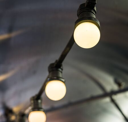 Vintage antique hanging light bulbs at a street food market