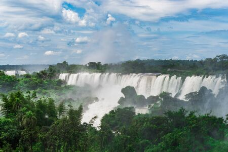 Wide angle landscape of Iguazu falls waterfalls. Photo from Argentinian side. Stock Photo