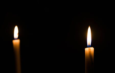 Candle light flame. Concept of memory, remembrance, mourning, grief, and sorrow.